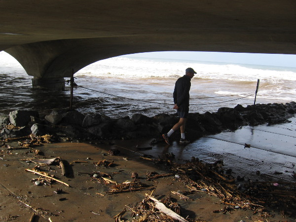 Debris has been washed by the ocean under the Los Peñasquitos Lagoon bridge at Torrey Pines State Beach.