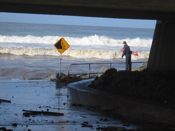 A lifeguard keeps an eye on wild surf at Torrey Pines State Beach.