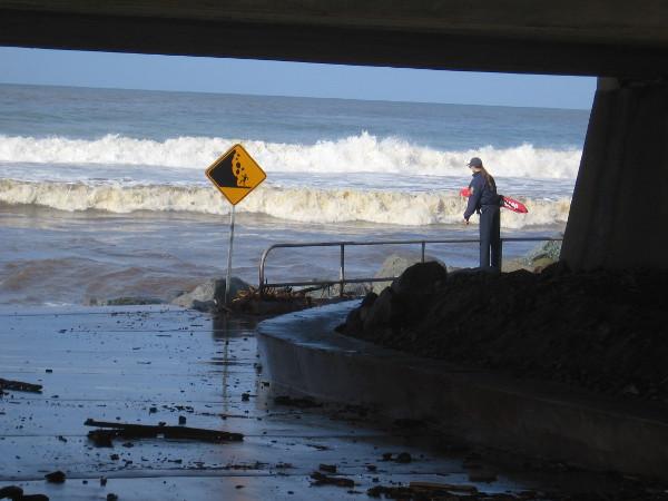 A lifeguard keeps an eye on wild surf at Torrey Pines State Beach.