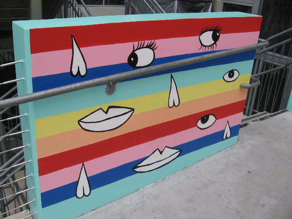 Section of SMILE, by artist PANCA. The fun 48-foot-long mural decorates the bridge leading to the entrance of The New Children's Museum.