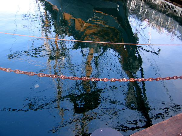 Reflection on the water of HMS Surprise.