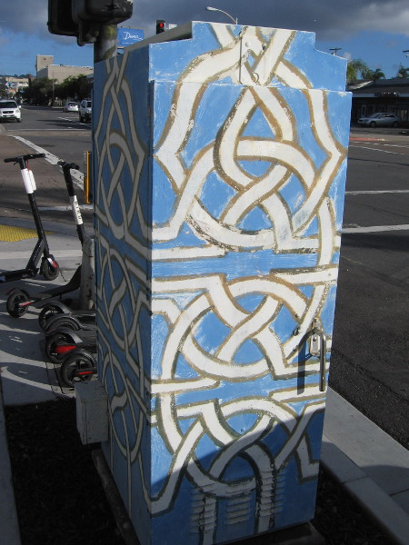 Interwoven geometric design on an electrical box.