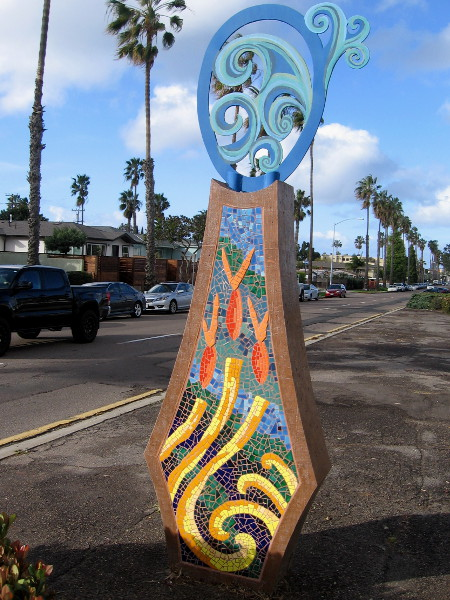 Closer photo of the beautiful mosaic sculpture titled Waves, created by artist Kim Emerson in 2002.