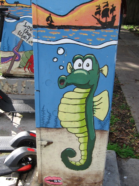 A funny green seahorse and pink clam.