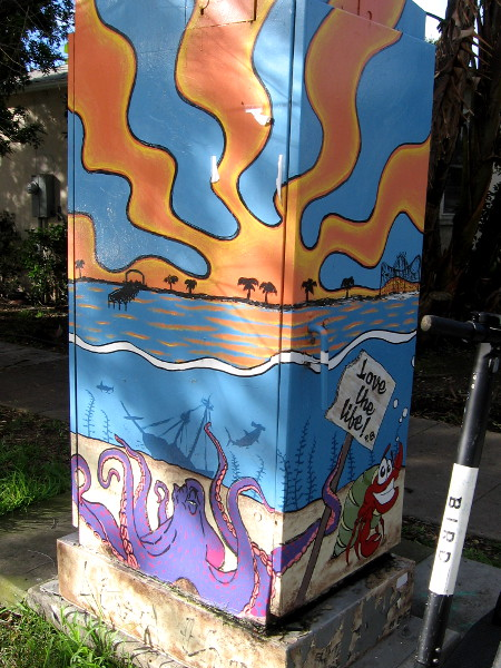 Fun street art on two sides of one box.