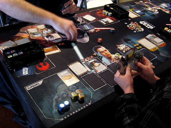 Players try out Star Wars Destiny, a dueling dice and card game.