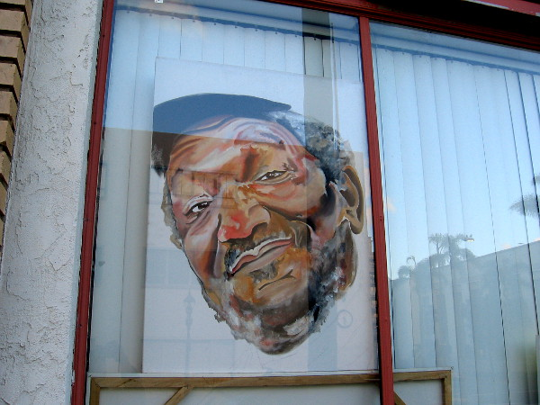 This cool face on a window is by artist Almighty Savo.