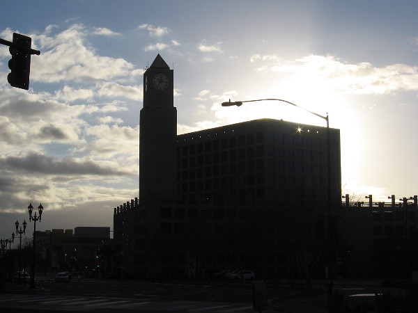 The sun will soon appear above the MTS building at 12th and Imperial.