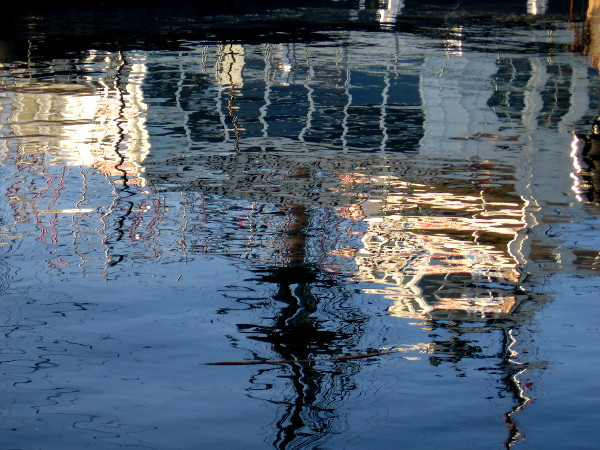Reflection on the water of HMS Surprise and Steam Ferry Berkeley.