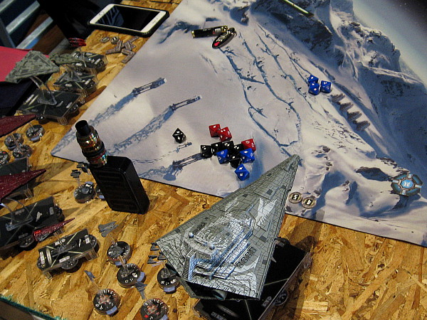 A cool game mat depicts the Star Wars ice planet Hoth.