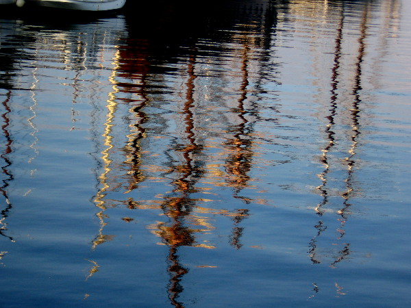Reflection on the water of Medea, Pilot, America, San Salvador, and Californian.