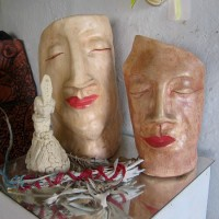 Ceramic faces express humanity and heart.