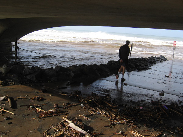 Mud and debris under the bridge. The result of a strong winter storm and the mighty ocean.