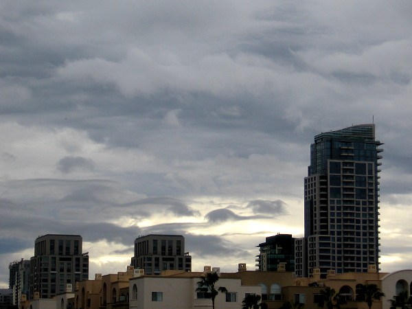 Clouds above downtown precede a heavy winter storm.
