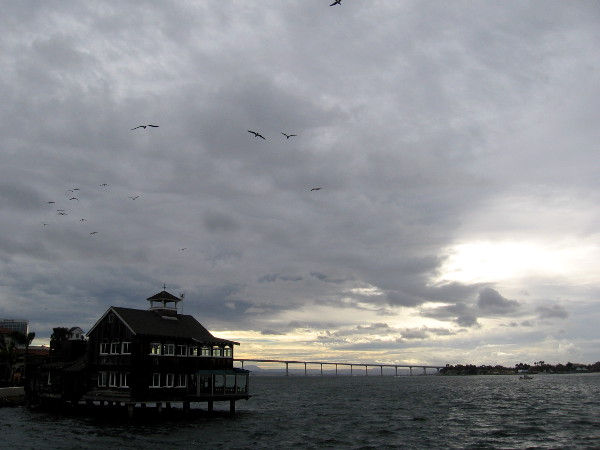 Some light in the distance beyond the Coronado Bay Bridge as clouds deepen.