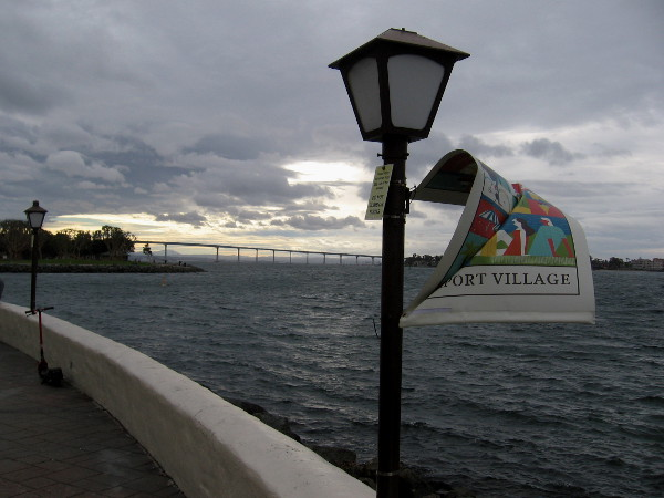 A Seaport Village banner twists in a gust.