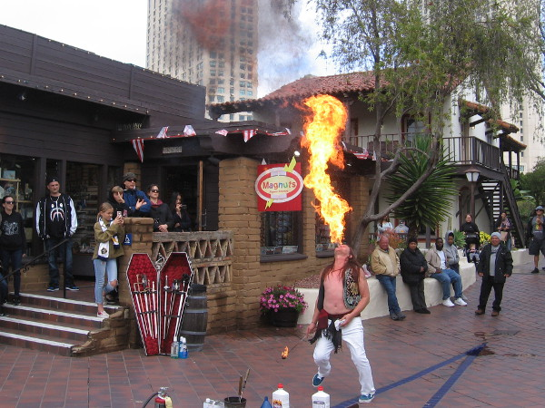 San Diego's own world-famous Murrugun the Mystic exhales a huge fireball during Seaport Village's 2019 Busker Fest!