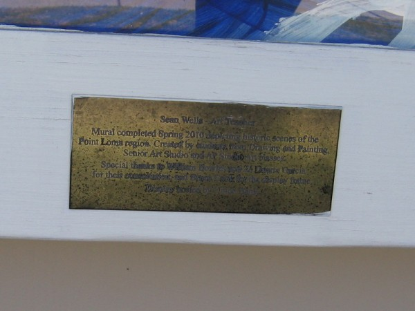Plaque describes the artwork. Sean Wells - Art Teacher. Mural completed Spring 2010 depicting historic scenes of the Point Loma region.