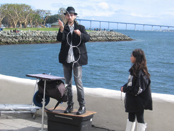 Back near the water, Jonathan Strange was doing ring linking magic with an assistant from the audience.