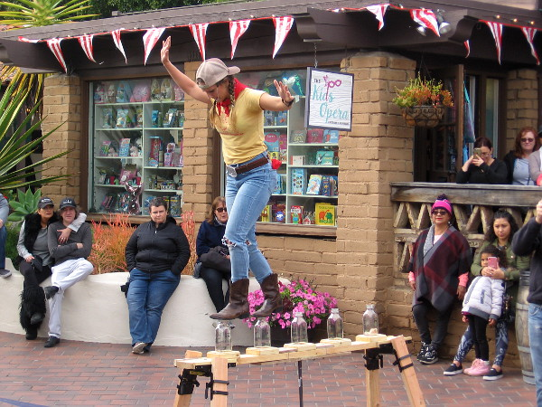 The Farmer's Daughter keeps balance as she walks along the top of glass milk bottles--with one good eye! A wildly successful show, in spite of her contact lens difficulty!