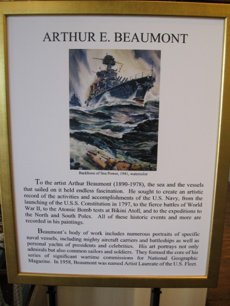 Sign describes the life and work of Arthur E. Beaumont, named by the Navy the Artist Laureate of the U.S. Fleet in 1958. He is also known for his wartime commissions for National Geographic Magazine.