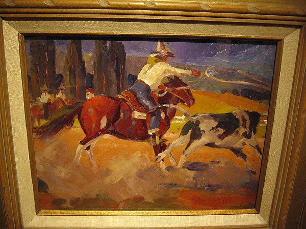 Cowboy at the Corral Lassoing a Steer, oil, 1929. The Bowers Museum.