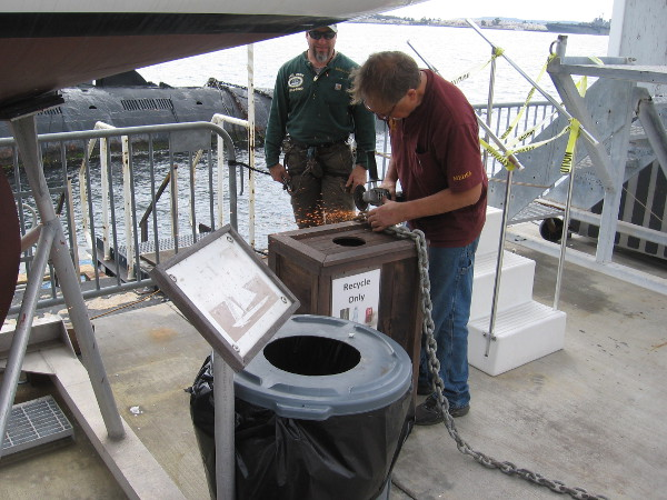 Guys at the Maritime Museum of San Diego were busy cutting a chain on the barge.