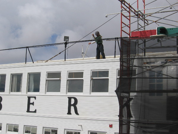 Another volunteer cleans the top of Steam Ferry Berkeley. Good progress is being made on this historic ship's exterior restoration!