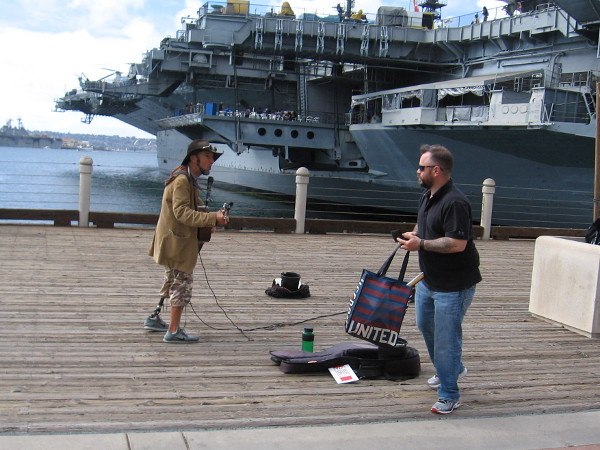 Cool guy Gary Reid provides soulful music by the USS Midway.