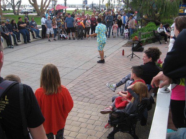 Today is the second day of Seaport Village's annual busker festival. George Gilbert from Fort Myers Beach, Florida entertains a good crowd.