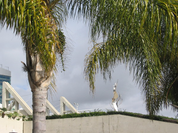 The Flame of Friendship sculpture gleams up on the San Diego Convention Center.