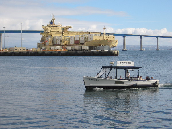 A water taxi comes in from Coronado. That huge yellow Dole Atlantic ship is loading containers at the Tenth Avenue Marine Terminal.