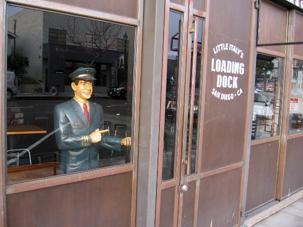 A friendly attendant stands by in a window of Little Italy's Loading Dock.