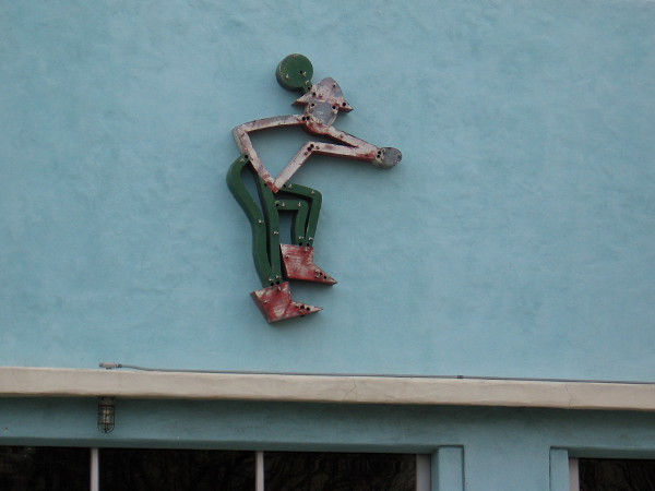 Peculiar figure above the front windows of Architectural Salvage.