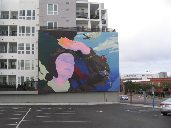 A colorful new mural decorates the AV8 Apartments in Little Italy.