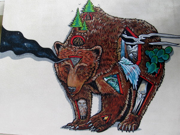 An abstract bear mural by @SKYEWALKER_ART appears to contain lots of nature symbolism.