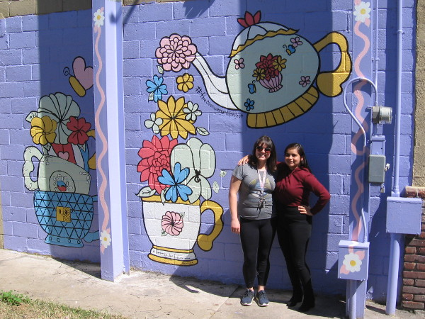 Naomi GonzalezMartinez (to the right) poses by her new mural in City Heights with her artistic mentor Brise Birdsong.