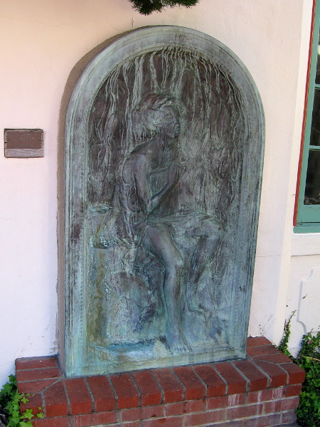 Bronze artwork near the Athenaeum's rotunda. Young Girl Holding Book by Merrell Gage, 1925.