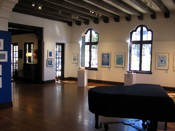 Sunlight filters through windows and shines on wood inside the Athenaeum's spacious Joseph Clayes III Gallery.