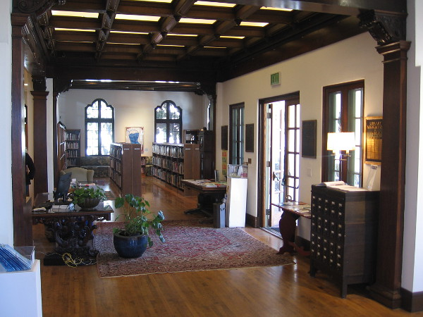 Inside the beautiful, welcoming Athenaeum. Gazing east at shelves and windows.