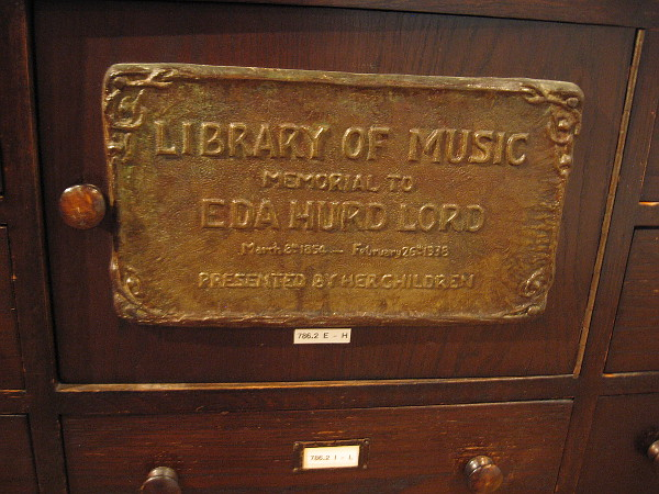 Library of Music small plaque on drawer.