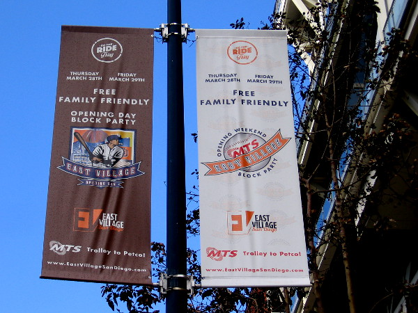 The first street lamp banners to go up promote the free, family friendly Opening Day Block Party. The annual event will take place Thursday and Friday next week in East Village.