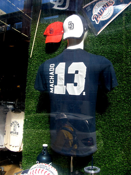 A new Manny Machado shirt is now on display in a window of the Padres Team Store.
