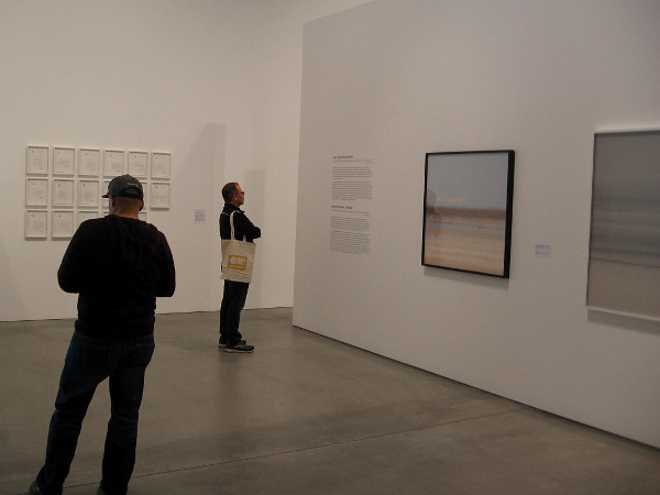 Visitors to the downtown Museum of Contemporary Art San Diego enjoy photographs and other pieces by Trevor Paglen.
