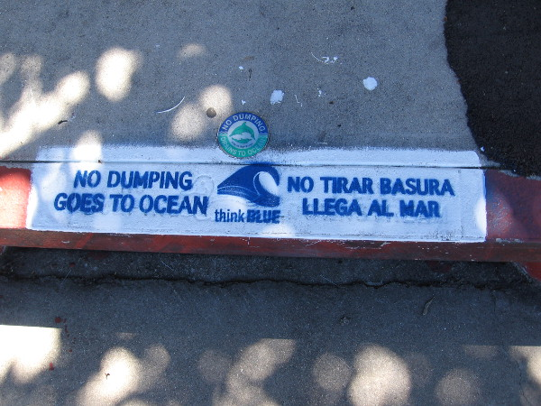 Newly stenciled message by a storm drain in Point Loma. NO DUMPING GOES TO OCEAN