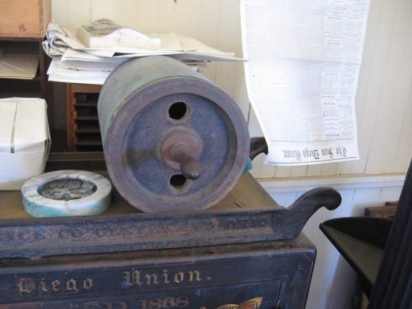 To proof newspaper sheets as type was assembled, this huge heavy roll would be used to make a quick impression.