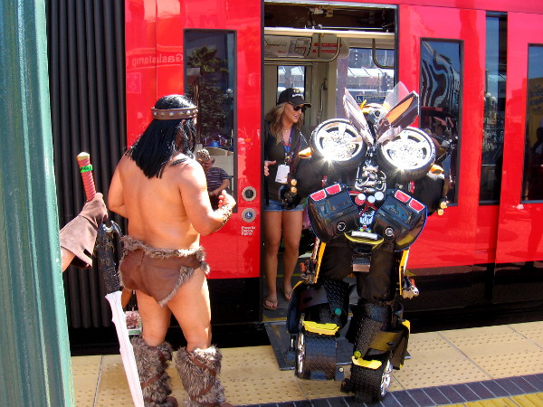 Bumblebee and barbarian friend boarding a trolley in San Diego
