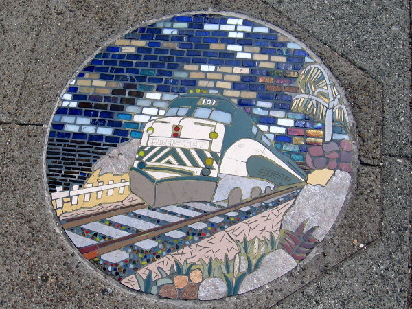Encinitas artwork near train station depicts Coaster coming down track.