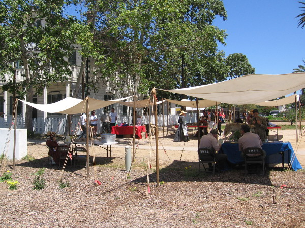 A row of tents near the McCoy House Museum welcomes curious visitors during the Earth Day Open House event.