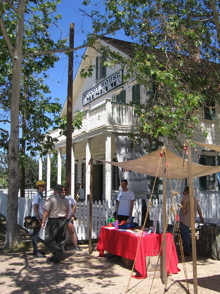 Participants in Old Town's Earth Day hang out by the McCoy House, which today serves as a museum of San Diego's early history.